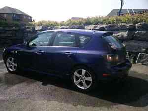 Mazda3 sport great condition. AC bluetooth, etc.