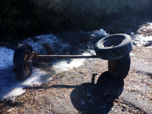 3500lb. Trailer axle with 3 rims