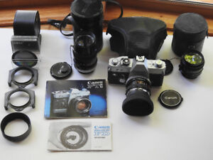 Canon FTB film camera and various lenses and filters.
