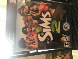 PC game The Sims 2 and four DVDs