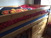 Single bed with desk and draws.