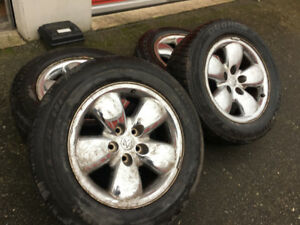 """set of 20"""" dodge ram rims and tires in fair condition"""