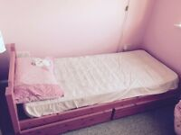 Pink bed with mattress
