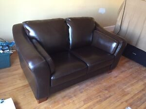 Sofa and chair in dark brown bicast leather. 400$ for both