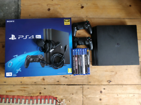 Playstation 4 Pro 1TB - 7 games, 2 controllers