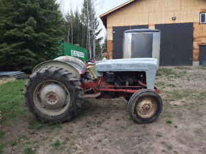 Ford tractor runs good has chains