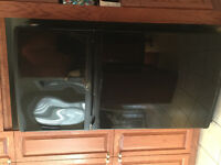 Whirlpool refrigerator PLUS stove and fan thermador
