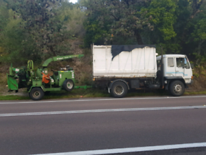 Tipper truck with chip bin and chipper
