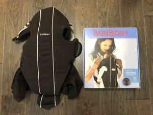 Baby Bjorn carrier with cover/blanket