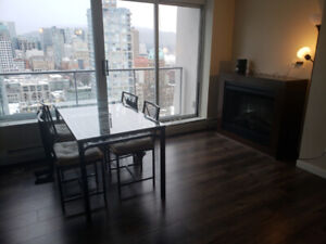 $1100 solarium  in  DT across Chinatown station and Rogers Arena