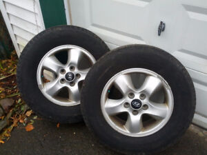 Two Michelin tires on rims
