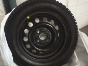 "14"" Goodyear Ultra Grip Ice winter tires on rims 185/65R14 81Q"