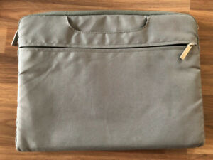 Grey laptop sleeve, new, multiple pockets, 11'' x 15''
