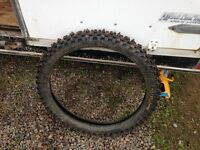 used 30/100-21 Motocross tire with Ice Studds.