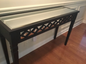Wood console table with mirrored top.