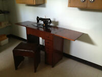 Singer Sewing Machine in table with padded bench