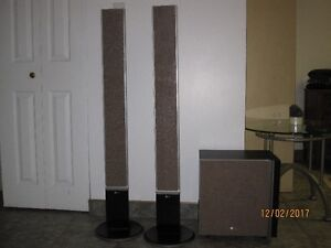 LG two surround speakers and a sub