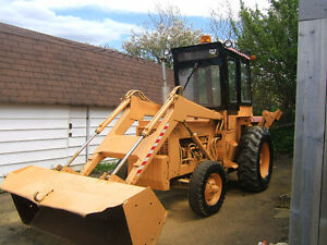 INT RUBBER TIRE BACKHOE IN GOOD COND $7300 ONO