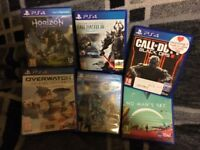 PS4 (white) 500GB HDD with controller, and recharge cable for controller, and six games!