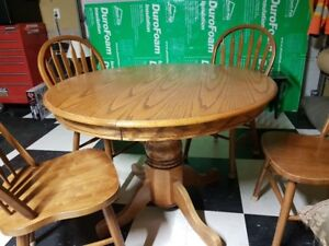 Solid Oak pedestal table / chairs / leaf included