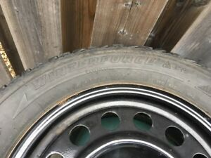 215/60 R15 Winterforce tires on rims