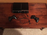 500GB PS3 with cables + 2 controllers & lots of extras