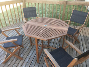 Wooden folding patio table and chair set.