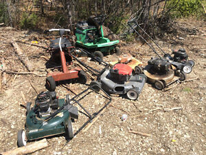 Set on lawn mowers for parts also push mowers, and snow blowers