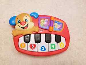 Fisher-Price Laugh and Learn Puppy's Piano Playset - English Edi
