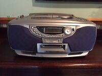 Portable CD, cassette & radio