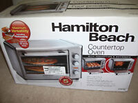 Brand new still in box counter top convection oven with rotissie