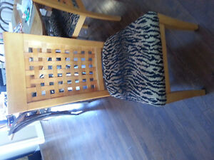 Wood dining chairs with animal print fbric.