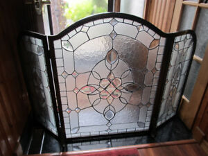 Stained glass fireplace screen.