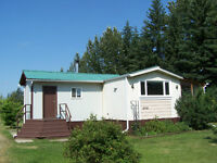 An Acreage Right In Town!!