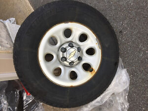 Set of 4 GM 265/70-17 winter tires on rims.