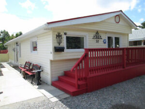"32 Root River Trailer Park""September Discount 20% Off Cash Offer"