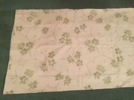 Pair of new lined curtains pale green flowers on a cream background