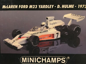 Minichamps 1/18 - F1 McLaren Ford M23 Yardley No. 7 Hulme 1973