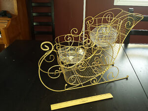 Two Gold Metal Plant Sleighs