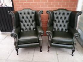 A Pair Of Dark Green Leather Chesterfield Queen Ann Arm Chairs