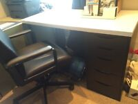 Ikea desk with shelving unit, chair, footrest