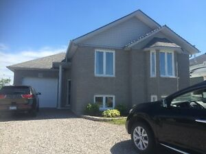 Bungalow for Sale in Garson on corner lot with garage!