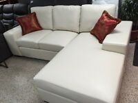 IVORY BONDED LEATHER SECTIONAL COUCH