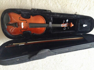 Menzel 1/2 size violin with bow and case, recently tuned. $130.