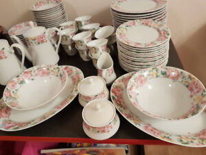 China set for 15 with serving pieces. Flower pattern