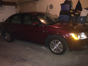 2008 Ford Taurus Red in colour 298,000 k call 306-515-0388
