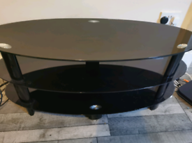 TV stand. Black glass