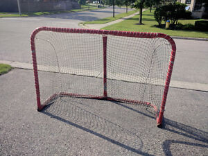 Classic 'Canadian Red' regulation steel hockey net for sale