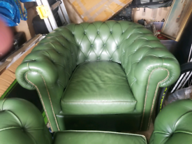 Pair of green Chesterfield armchairs