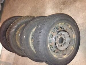 2 Tires 185 65 14 and 4 rims
